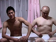 Team a few Asian guys take ever after other's attire off and sit on the adjoin stroking their cocks