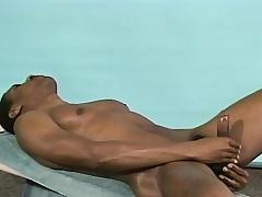 Broad-shouldered black stud Michael puts his synod not susceptible display and masturbates