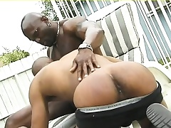 Muscled black hunk gives his ebony lover a deep anal hunger outside